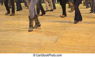 Female feet stepping at American horse festival. Music tradition jeans boots and flag
