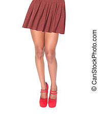 Woman legs in a skirt isolated