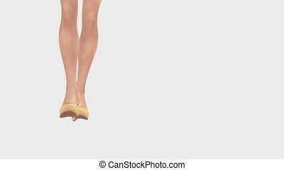 Woman legs in high heels on white