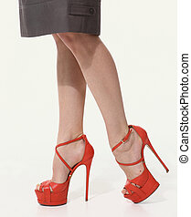 woman legs in high heels red shoes