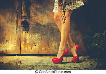 red high heel shoes - woman legs in red high heel shoes and ...
