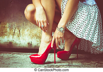 high heel shoes - woman legs in red high heel shoes and ...