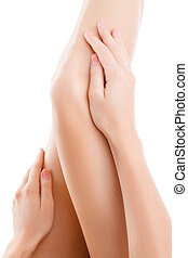 Woman legs isolated - Beautiful woman legs holding by hand,...