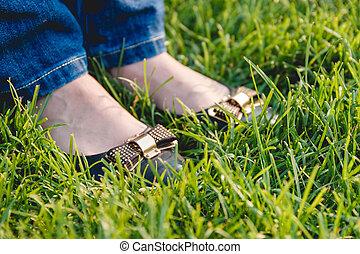Woman Legs on Green Grass