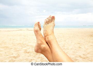 Legs on the beach.