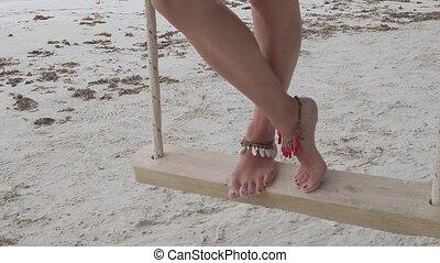 woman legs on tree swing