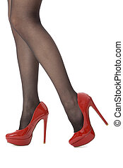 Woman Legs Wearing Red Shoes and Gray Stockings