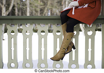 Woman legs with boots at terrace boundary - Young woman legs...