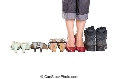 Woman Legs With Heels And Old Shoes