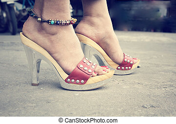 woman legs with high heel shoes