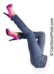Woman legs with jeans and fuchsia high heels pointing up...