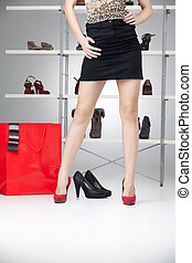 woman legs with red high heels