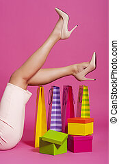 Woman legs with shopping bags