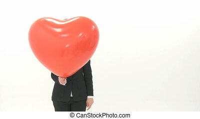 Woman lets heart balloon fly and looks afterward