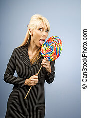 Woman licking a lollipop