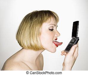 Woman licking phone.