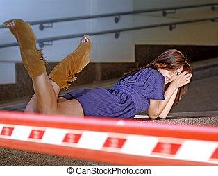 woman lies in the garage
