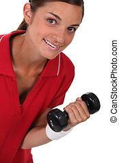 Woman lifting a dumbbell