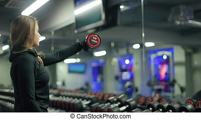 Woman Lifting Dumbbells Weights and Sweating - Active...