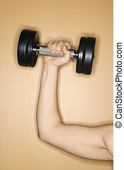 Woman lifting hand weight.
