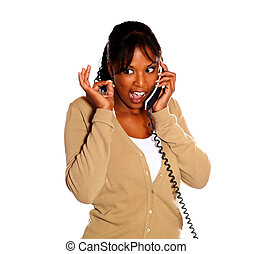 Woman lifting the fingers up and speaking on phone