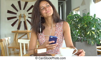 Woman listen to music on smartphone with headphones.