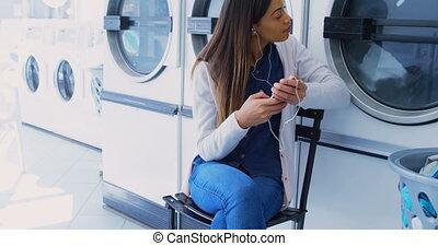Woman listening music on mobile phone 4k - Woman listening...