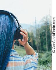Woman listening music outdoor.