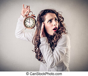 Woman listening to clock