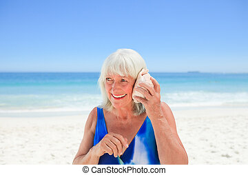 Woman listening to her shell