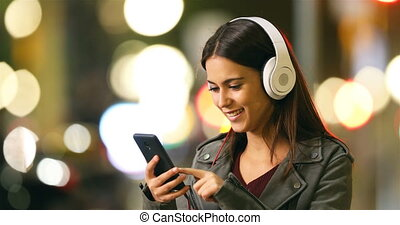 Woman listening to music in the night - Happy woman...