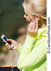 woman listening to music outdoors - sport and lifestyle...