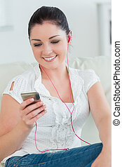 Woman listening to music while sitting on the couch