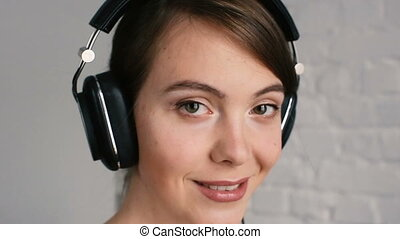Woman listening to music with headphones close up