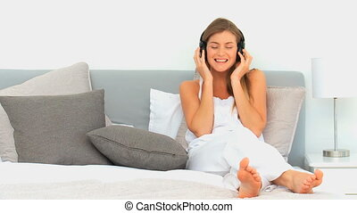 Woman listening to some music on th
