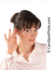 Woman listening with hand to ear.