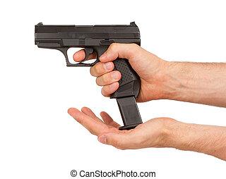 Woman loading a black gun