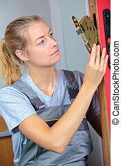 woman locksmith   doing a repair