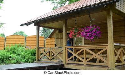 woman log house gate