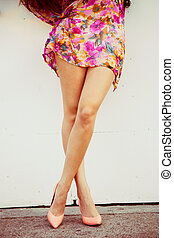 woman long legs - woman tan legs in high heel shoes and...