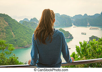 Woman look on HALONG bay in Vietnam from TiTop island. UNESCO World Heritage Site.