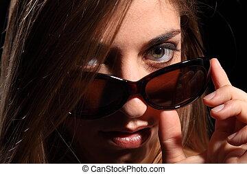 Woman look sexy in dark sunglasses