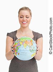 Woman looking a globe
