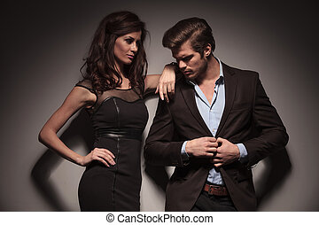 woman looking and leaning on her boyfriend