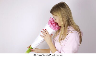 Woman looking at a bouquet of pink tulips