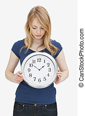 Woman looking at a clock