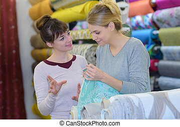 woman looking at a fabric