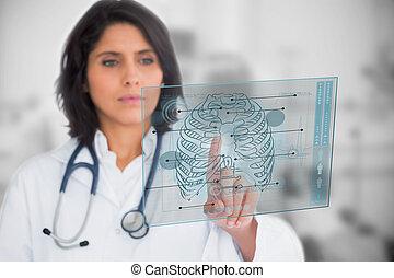 Woman looking at a medical interface