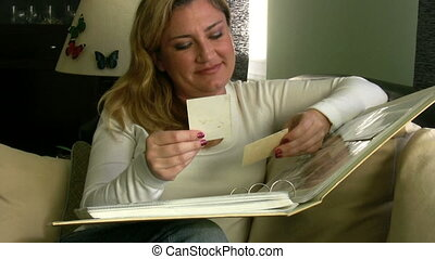 Woman Looking at a Photo Album