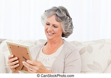 Woman looking at a photo